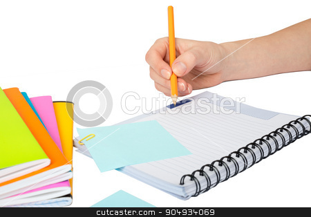 Females hand writing in notebook stock photo, Females hand writing in notebook on isolated white background by cherezoff