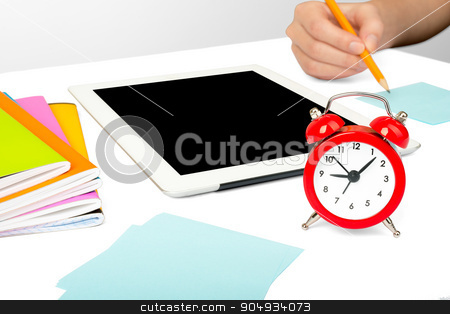 Females hand using tablet stock photo, Females hand using tablet isolated on white background with alarm clock by cherezoff