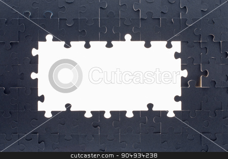 Grey puzzle background with empty space stock photo, Puzzle background with big empty white space, close up view by cherezoff