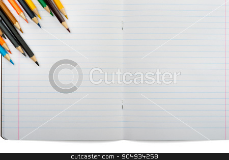 Open notebook with set of crayons stock photo, Open notebook with crayons on isolated white background, closeup by cherezoff