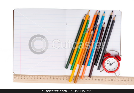 Open notebook with set of crayons and alarm clock stock photo, Open notebook with crayons, ruler and alarm clock on isolated white background, closeup by cherezoff