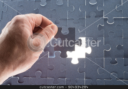 Missing jigsaw puzzle piece with light glow stock photo, Missing jigsaw puzzle piece for completing the final puzzle piece by cherezoff