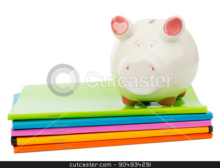 Piggy bank on pile of copybooks stock photo, Piggy bank on pile of copybooks on isolated white background, front view by cherezoff