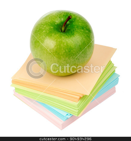 Fresh green apple on stack of stickers stock photo, Fresh green apple on stack of stickers on isolated white background by cherezoff