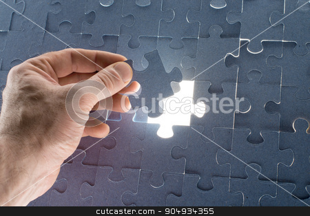 Missing jigsaw puzzle piece with light glow stock photo, Missing jigsaw puzzle piece for completing the final puzzle piece, closeup by cherezoff