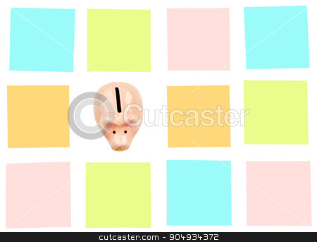 Piggy bank with colorful stickers stock photo, Piggy bank with colorful stickers on white by cherezoff