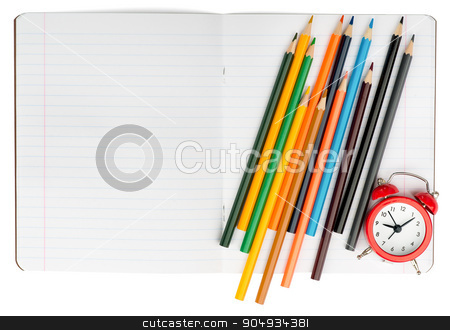 Open notebook with set of crayons stock photo, Open notebook with crayons and alarm clock on isolated white background, closeup by cherezoff