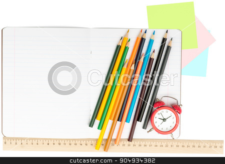 Open notebook with set of crayons and alarm clock stock photo, Open notebook with crayons, stickers and alarm clock on isolated white background, closeup by cherezoff