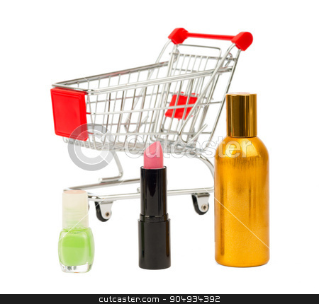 Shopping cart with nail polish and perfume stock photo, Shopping cart with nail polish and perfume on isolated white background by cherezoff