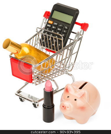 Calculator and perfume in shopping cart stock photo, Calculator and perfume in shopping cart with piggy bank on isolated white background by cherezoff