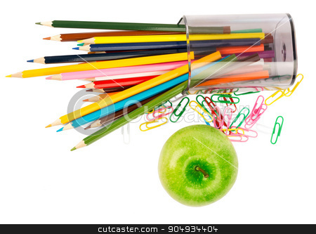 Fresh apple with crayons stock photo, Fresh apple with crayons and paper clips on white background by cherezoff