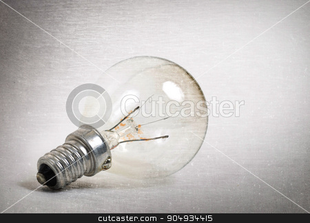 Old lightbulb isolated on a white background stock photo, Old lightbulb isolated on a white background - Vintage look by michaklootwijk