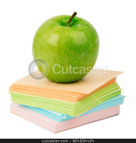 Fresh apple on stack of stickers stock photo, Fresh apple on stack of stickers on isolated white background by cherezoff