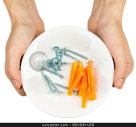 Female hands holding plate with screws stock photo, Female hands holding plate with screws on isolated white background by cherezoff