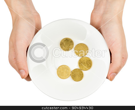 Female hands holding plate with coins stock photo, Female hands holding plate with coins on isolated white background by cherezoff
