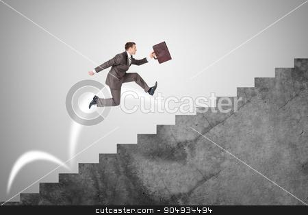 Businessman running up stairs stock photo, Businessman with suitcase running fast up stairs by cherezoff