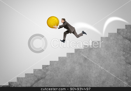 Businessman running down stairs holding big coin stock photo, Businessman with big gold coin running fast down stairs by cherezoff