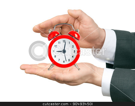 Male hands holding alarm clock stock photo, Male hands holding alarm clock on isolated white background by cherezoff