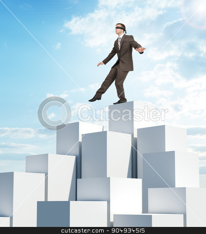 Businessman walking from edge of boxes pile stock photo, Businessman walking from edge of boxes pile on blue sky background by cherezoff