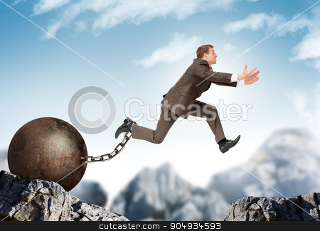 Businessman jumping over gap stock photo, Image of young businessman with iron ballast jumping over gap by cherezoff