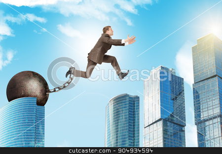 Young man jumping over gap stock photo, Image of young businessman with iron ballast jumping over gap on city background by cherezoff