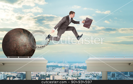 Image of young man jumping over gap stock photo, Image of young businessman with suitcase and iron ballast jumping over gap by cherezoff