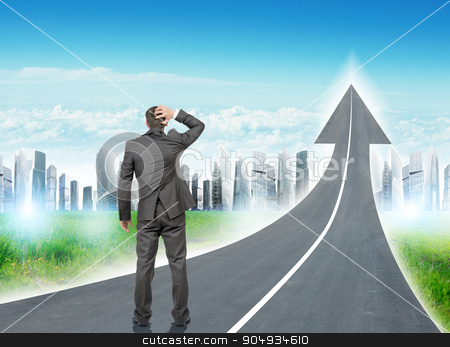 Man standing on freeway going up as arrow stock photo, Businessman standing on freeway road going up as an arrow in sky by cherezoff