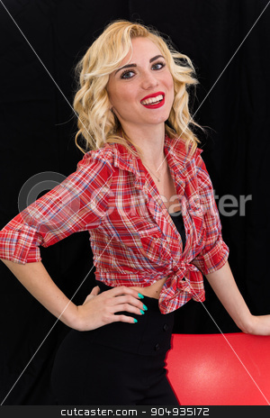 Young girl, pin up typical American. stock photo, Young girl, pin up typical American. With pants or leggings and long blacks, on a black background, red and white checkered shirt, knotted navel, features dazzling smile. by GCammarata
