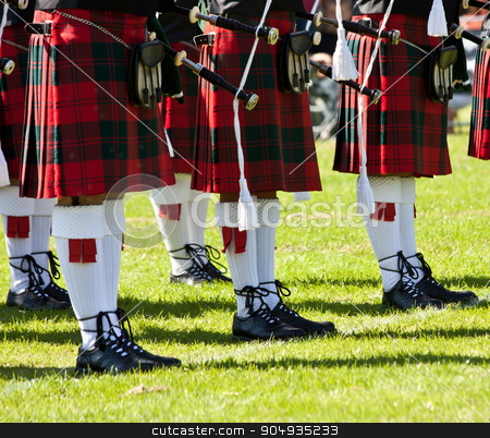 Scottish kilts stock photo, Detail of original Scottish kilts, during Highlands games by Paolo Gallo