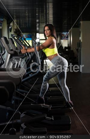 Latin Women On Elliptical Treadmill In Fitness Gym stock photo, Fitness Girl Exercising On Moonwalker Treadmill Gym Equipment by Jasminko Ibrakovic
