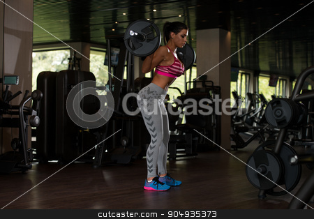 Mexican Woman Doing Exercise Barbell Squat stock photo, Sexy Latino Woman Working Out Legs With Barbell In Fitness Center - Squat by Jasminko Ibrakovic