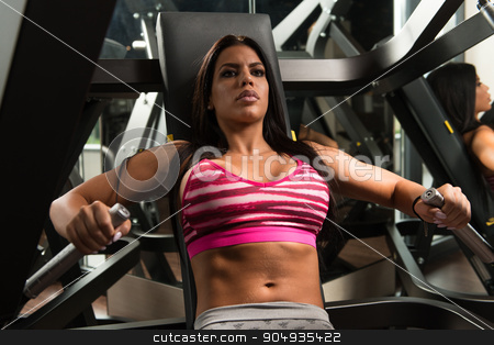 Young Mexican Woman On Bench Press stock photo, Young Latina Woman In Gym Exercising On The Bench Press by Jasminko Ibrakovic