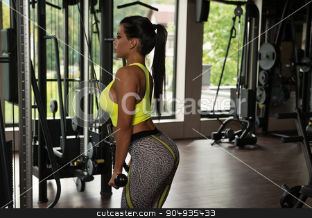 Latina Woman Doing Heavy Weight Exercise For Triceps stock photo, Latino Woman Athlete Doing Heavy Weight Exercise For Triceps by Jasminko Ibrakovic