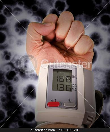 High blood pressure stock photo, Wrist blood pressure monitor concept photograph by Dariusz Miszkiel