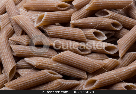 Raw brown pasta - background food concept stock photo, Photo of raw uncooked brown wheat organic pasta by Michal