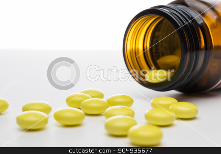 Close up of pharmaceutical drugs - pills stock photo, Isolated shot of yellow pharmaceutical drugs - pills by Michal