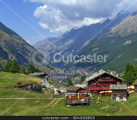 View on Zermatt village stock photo, View on chalets and Zermatt village by day by Elenarts