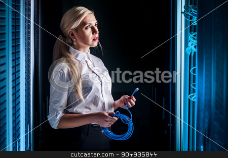 Young engineer businesswoman in network server room stock photo, Young engineer businesswoman in network server room. Russia. by agnormark