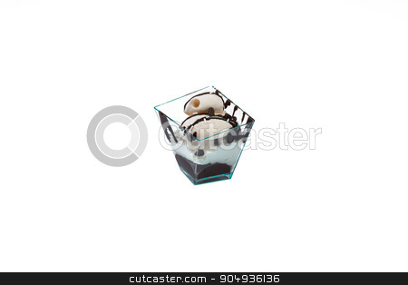 Cupcake with choccolate and cream stock photo, In the picture a cupcake with choccolate and cream in a plastic cup,isolated on white background. by Robertobinetti70