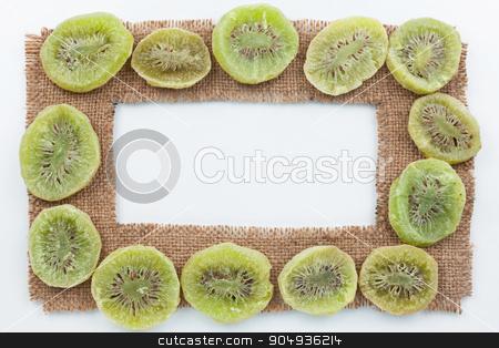 Frame made of burlap with dried kiwi stock photo, Frame made of burlap with dried kiwi, on a white background by alekleks