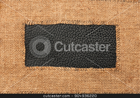 Frame of burlap, lies on a background of leather stock photo, Frame of burlap, lies on a background of leather, with place for your text by alekleks