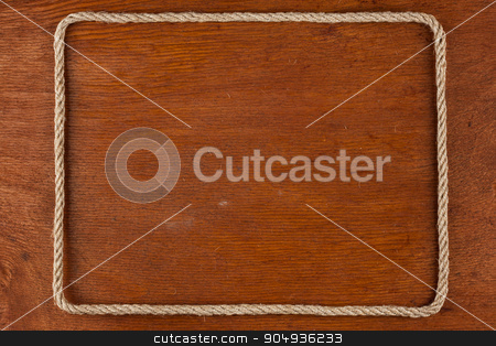 Frame of rope, lies on a background of a wooden surface stock photo, Frame of rope, lies on a background of a wooden surface, with place for your text by alekleks
