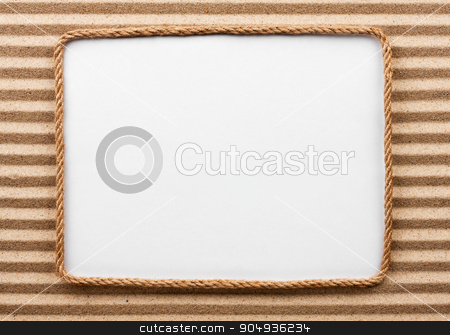 Frame made of rope with a white background on the sand stock photo, Frame made of rope with a white background on the sand, with place for your text by alekleks