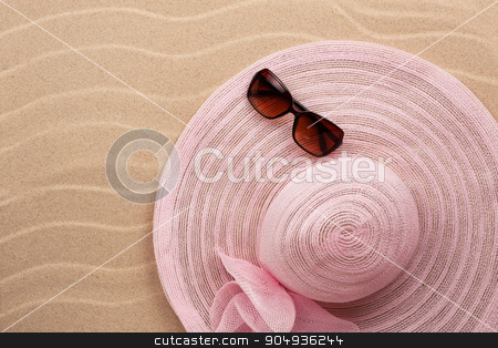 Accessories for the beach lying on the sand stock photo, Accessories for the beach lying on the sand, with place for your text by alekleks