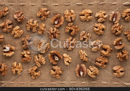 Peeled walnut  stock photo, Peeled walnut lying on sackcloth  by alekleks