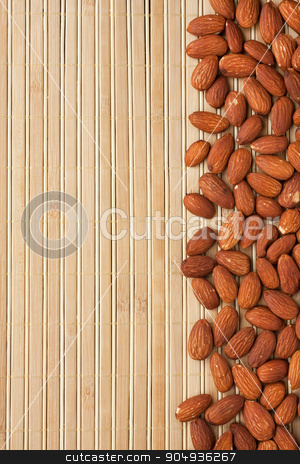 peeled almonds lying on a bamboo mat  stock photo, peeled almonds lying on a bamboo mat can be used as background by alekleks