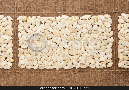 Pumpkin seeds on sackcloth, with place for your text stock photo, Pumpkin seeds on sackcloth, with place for your text, drawing by alekleks