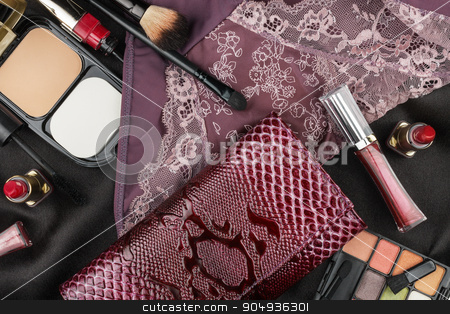 Beautiful clothes and cosmetics stock photo, Beautiful clothes and cosmetics lying on white satin as a background by alekleks