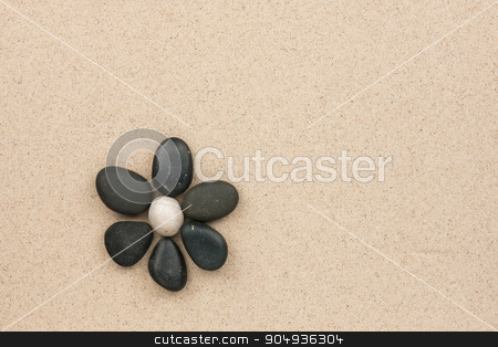 flower made with stones  stock photo, flower made with stones on a sand background  by alekleks