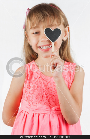 Girl holding a heart stock photo, Girl holding a heart, on a white background by alekleks